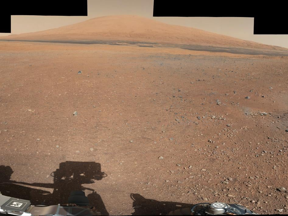 Here's the landing site of the Curiosity rover with Mount Sharp in the background. Source: NASA