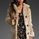A decadent faux fur layer that'll warm up your slinkiest sequined frock.  MinkPink Double Agent Fur Coat ($140)