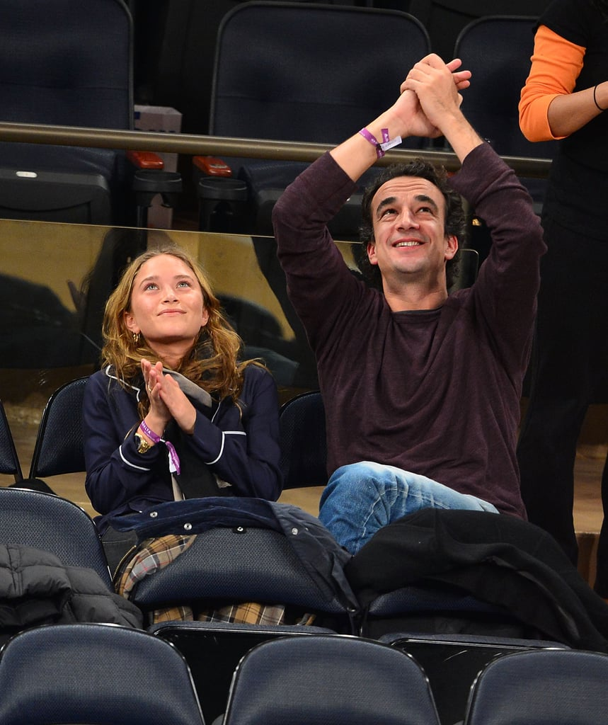 Mary-Kate Olsen and Olivier Sarkozy clapped in the stands together.