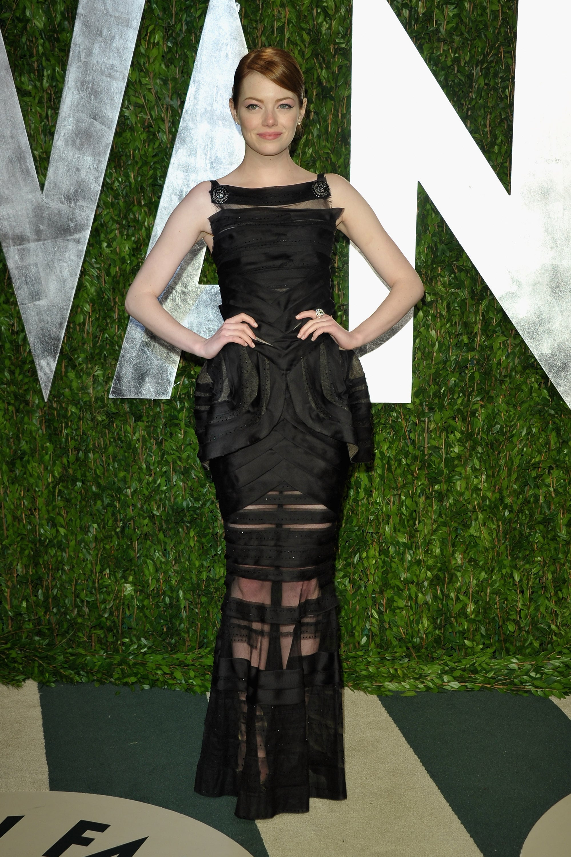Emma Stone strikes a pose at the Vanity Fair Oscar party.