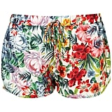 You can wear these shorts to the beach easily, but we think that a pair of slick white sandals and a silky blouse will dress up these shorts effortlessly. Topshop Tropical Floral Print Running Shorts ($56)