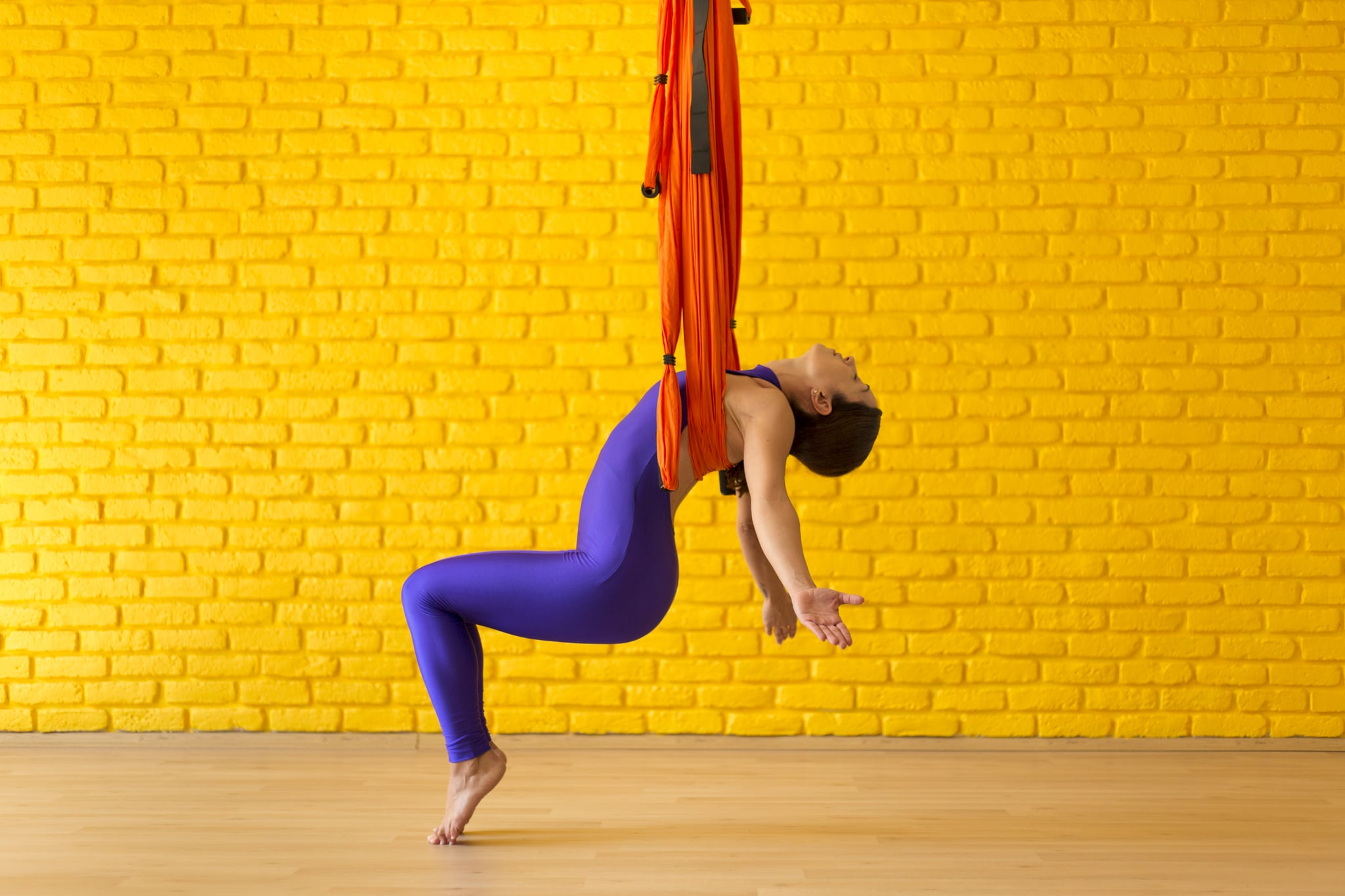 Young Woman doing Antigravity Yoga