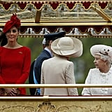 The queen looked at Kate on the royal barge.