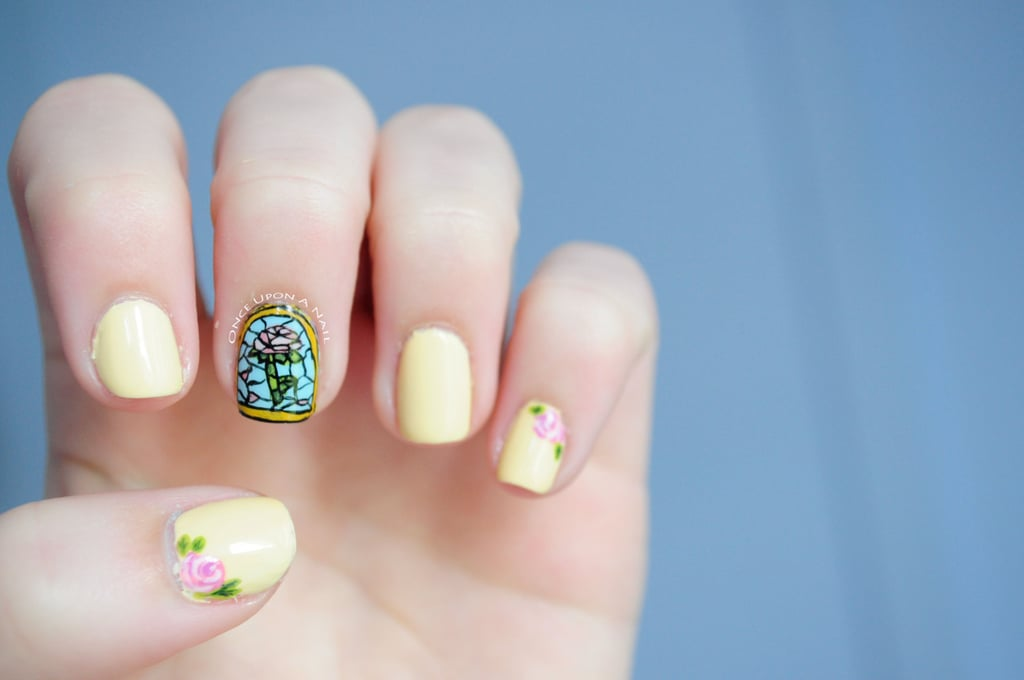 Forget finger paints! Take the easy route when attempting Beauty and the Beast nail art with these 10 gorgeous  OnceUponANail Disney Belle Beauty and the Beast Inspired ($14) decals. The images were inspired by the stained-glass windows in the Beast's castle, the enchanted rose, and Belle's yellow ballgown.