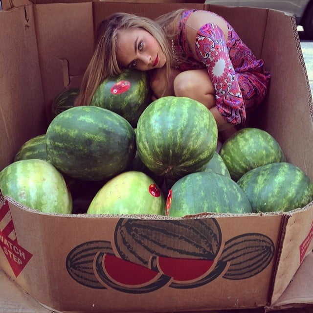 Cara Delevingne sat in a box of watermelons. Source: Instagram user caradelevingne
