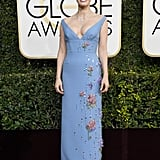 She wore a bead-embellished Prada dress with Piaget jewels to the 2017 Golden Globe Awards.