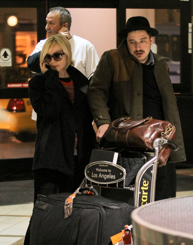 Carey Mulligan and husband Marcus Mumford pushed their bags through the airport.