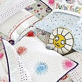 Margherita Missoni Daisy Decorative Pillow ($40), Margherita Missoni Embroidered Bunny Lumbar Decorative Pillow ($25)