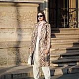 For a sporty-chic look, team full-length trousers with chunky sneakers and a pop of snake print.