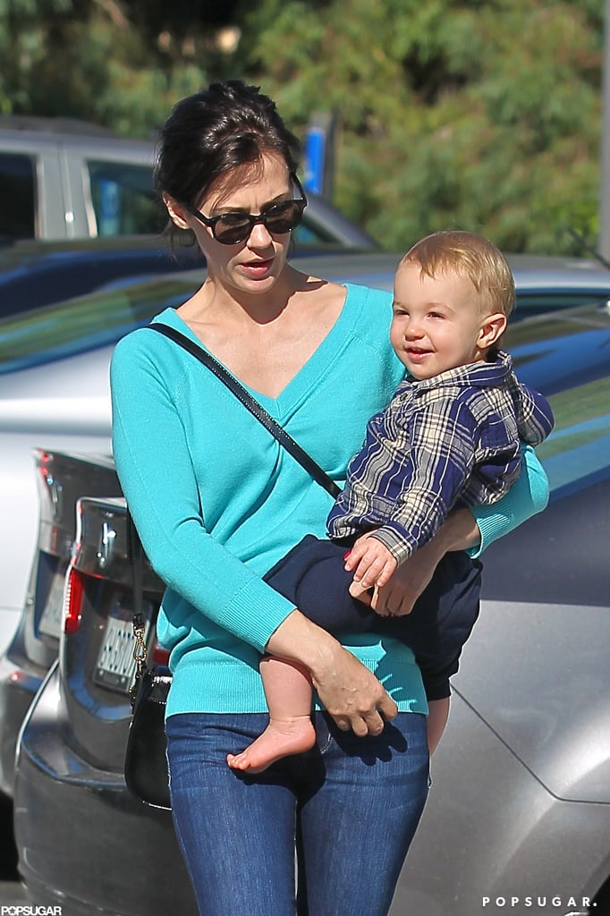 Xander Jones flashed a smile as January Jones carried him.