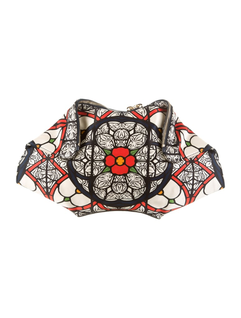 A unique Alexander McQueen De Manta Clutch ($395) like this is the one and done solution to an instant look-at-me outfit. — SW