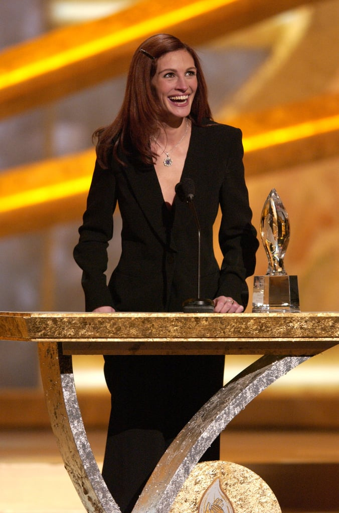 Julia Roberts flashed her famous smile while accepting her award for favourite motion picture actress in 2002.