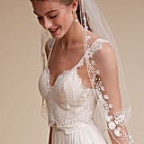 Belgian-inspired embroidery dots this BHLDN veil ($375) for a romantic feel.