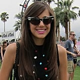 A quirky pair of shades plays off her sparkled top.