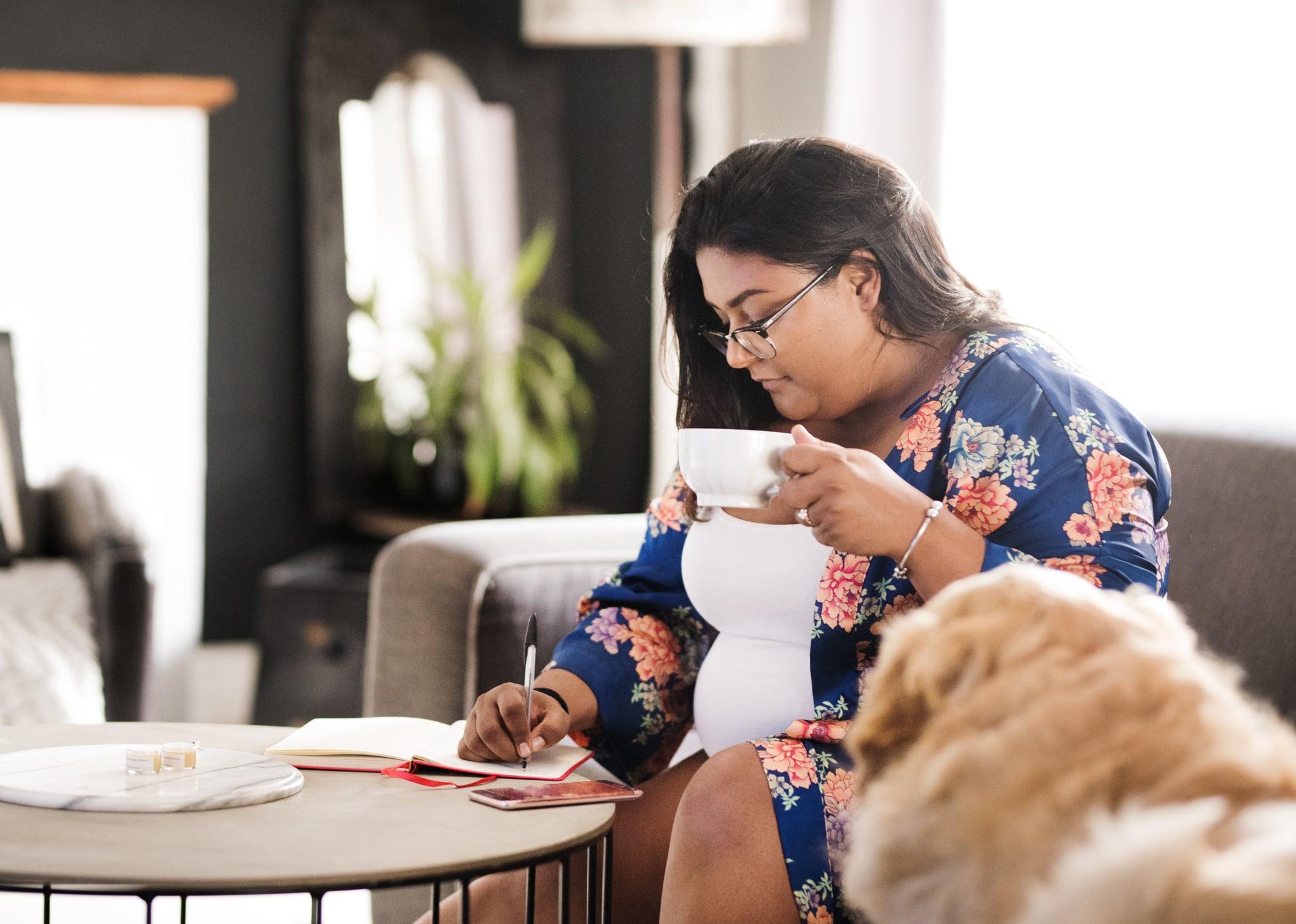Woman writing to-do list.