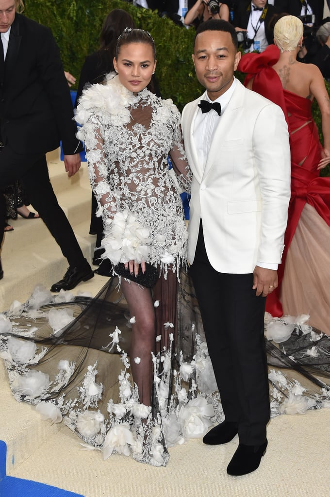 Attention, everyone: we have a few more adorable photos to add to Chrissy Teigen and John Legend's scrapbook. The superstar pair arrived at the Met Gala dressed to kill, both sporting coordinating shades of black and white. Chrissy, like Rihanna, stayed on-theme and opted for one of the night's more daring looks, later posing with Marchesa designer Georgina Chapman and fellow guest Rita Ora. Although there were tons of celebrity couples having a high-fashion date night at the annual event, Chrissy and John were obviously one of the cutest.
