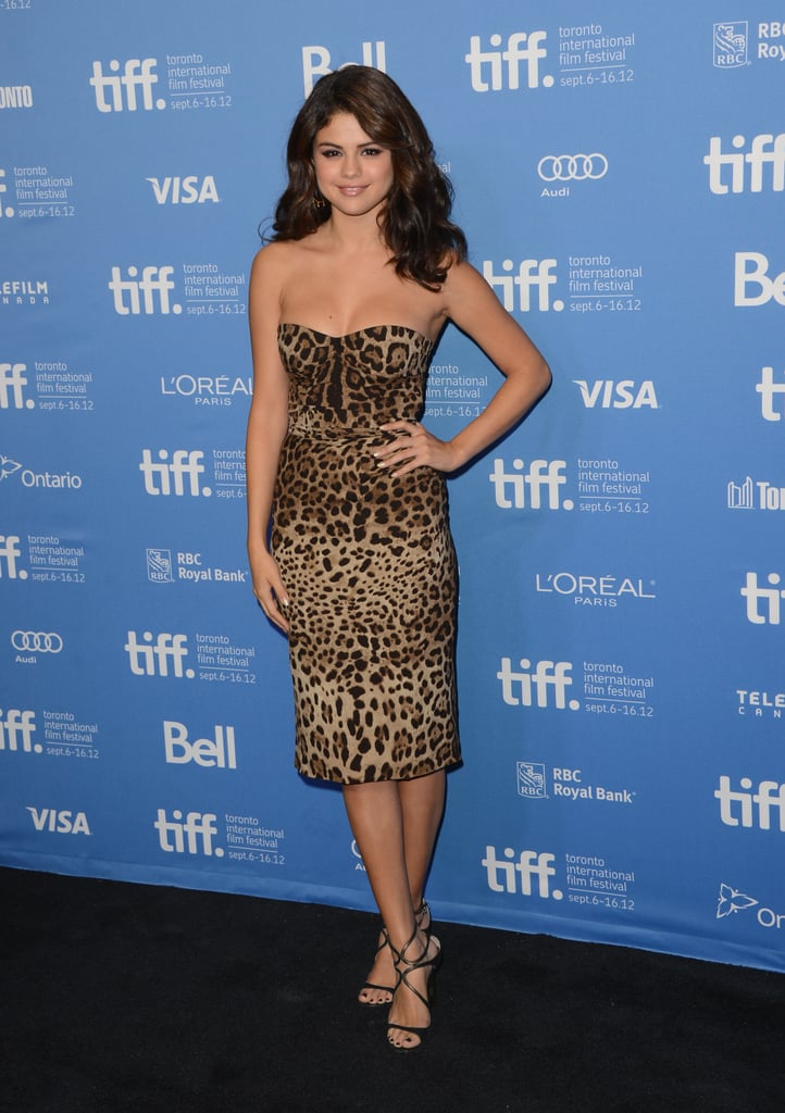 In a sexy move, Selena chose a wild leopard-printed Dolce & Gabbana strapless dress for the Spring Breakers photocall.