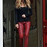 Elle Macpherson's red-leather pants make a black knit infinitely cooler than your average bottoms.