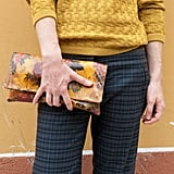 A mustard-hued floral clutch complemented this knit and added a little print interest against plaid pants. Source: IMAXtree