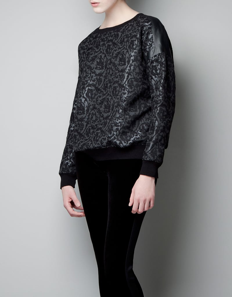 Following suit on the baroque trend, Zara's brocade knit sweatshirt ($70) gives us everything we need in the way of dark, moody romance with a side of textural elegance.