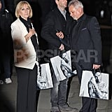 Victoria Beckham's parents, Jackie and Anthony Adams, held bags from David Beckham's H&M campaign.