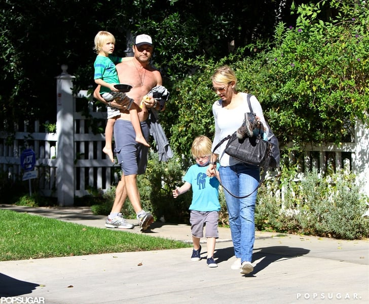 Naomi Watts and a shirtless Liev Schreiber walked with their kids.
