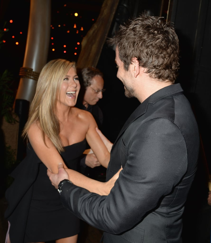 Jennifer Aniston and Bradley Cooper were happy to catch up backstage at LA's Guys Choice Awards.