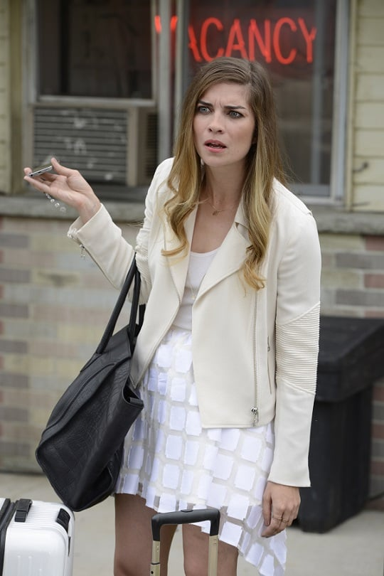 Ever accessorized, Alexis added a Celine tote to a look that's more New York City socialite than Schitt's Creek resident.