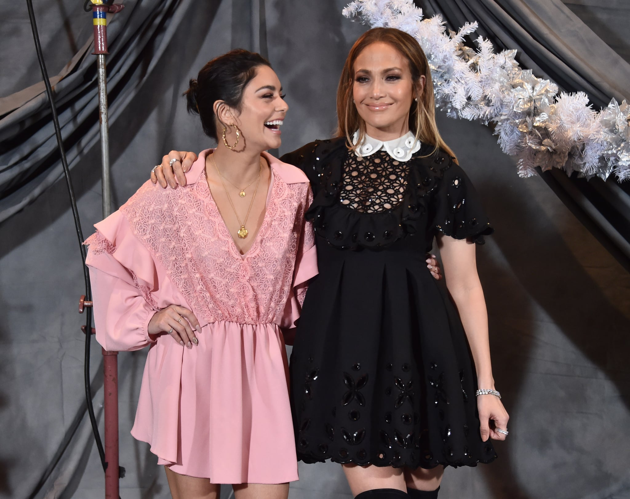 LOS ANGELES, CALIFORNIA - DECEMBER 09: Vanessa Hudgens and Jennifer Lopez attend a photo call for STX Films'