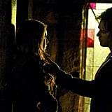 Elena (Nina Dobrev) and Damon share a weird moment.
