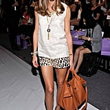Olivia kicked off Fashion Week in NYC at Noon by Noor, sporting a cool, ladylike mix of embellishment and print. She outfitted a pair of leopard-print Tibi shorts with a Noon by Noor shell and finished it all off with Lulu Frost jewels, a Meli Melo bag, and studded Valentino heels. 8762155