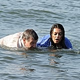 Mila Kunis and Robin Williams swam towards the beach.