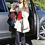 While heading into her office in Santa Monica, Jessica Alba worked a ribbed sweater with wide-leg denim, a burgundy satchel, and a navy Vince Camuto crossbody.