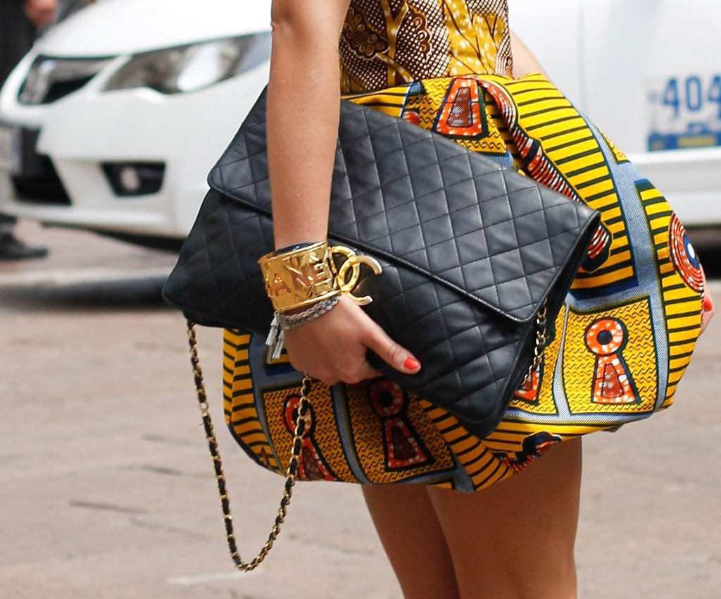 An oversize Chanel, a gilded cuff, and tribal print make an impressive trio.