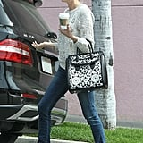 While grabbing coffee in LA, Diane Kruger dressed up her sweater and jeans with these on-trend Rachel Zoe colorblocked flats ($325) and a black-and-white Alexander McQueen bag.