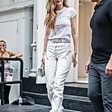 Going for all-white is easy when you have cool deconstructed Y/Project denim like Gigi. She wore her jeans with a plain white tee, Jacquie Aiche necklaces, and Aquazzura strappy heels.