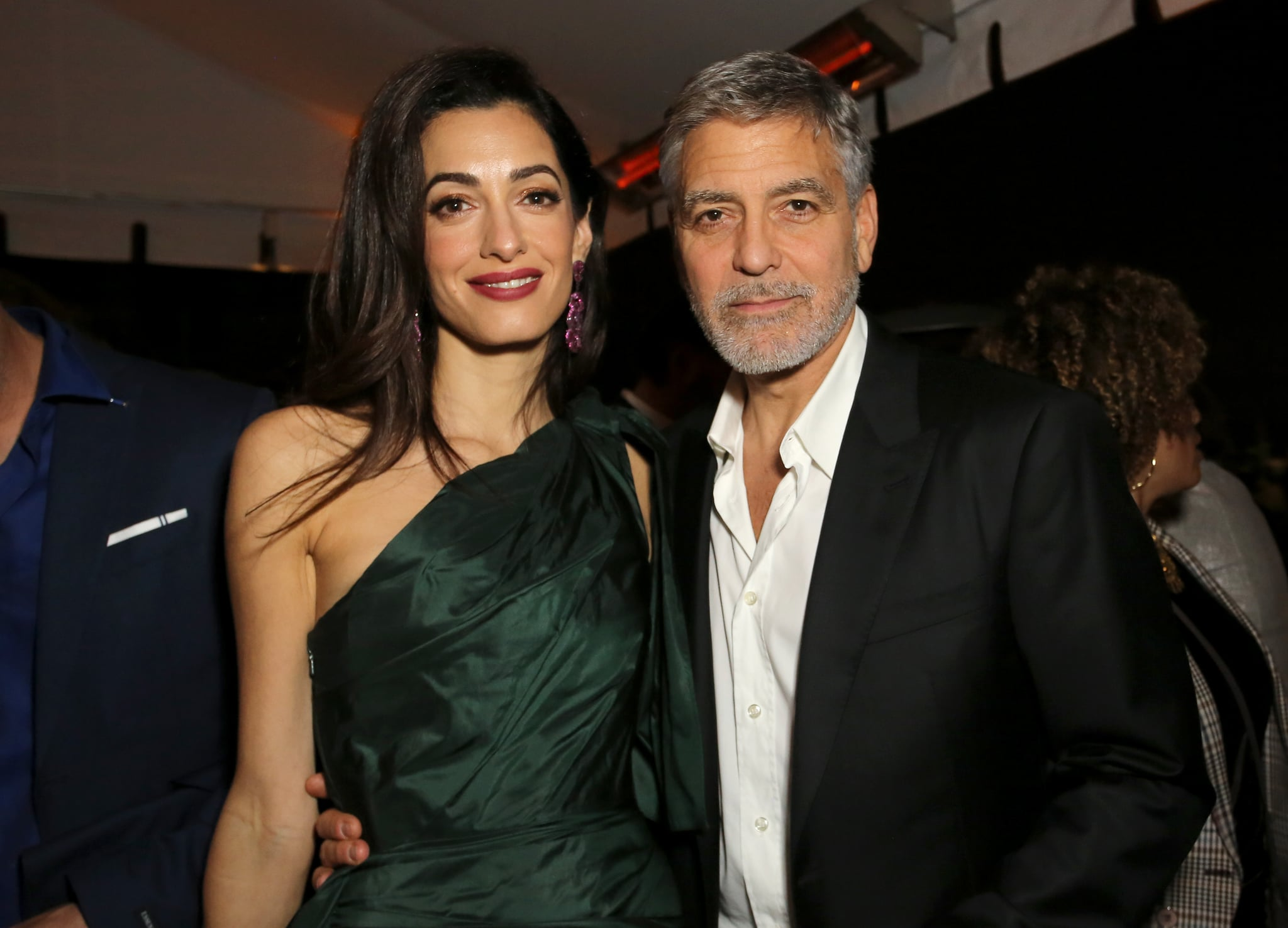 HOLLYWOOD, CALIFORNIA - MAY 07: (L-R) Amal Clooney and George Clooney attends the premiere of Hulu's