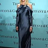 Gwyneth Paltrow donned a long-sleeved Ralph Lauren blue silk-mousseline gown paired with a Tiffany & Co. diamond brooch and bracelet.