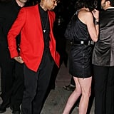 Chris Brown arrived at the afterparty in a red coat.