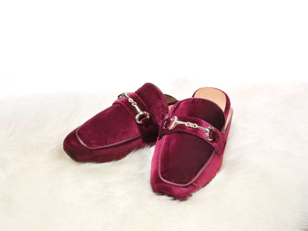 . . . then she'll love the idea of cozying up by the fire in these fuzzy slip-ons with a good read. Bonus points: these look like cozy indoor slippers, but they're actually stylish flats that can head outdoors.