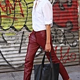 These oxblood leather pants are the kind you could build every outfit around for an always-cool effect. Source: Greg Kessler