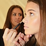 """Lead makeup artist Val Garland for Sephora Pro described the look perfectly. """"Think Californian girl. She's just gotten off the motorbike, tossed her hair, run into the surf, and got on a surfboard,"""" she explained. """"She's got this gorgeous, glowing tan.""""  To get the bronzed look, Garland used Hourglass Illume Crème-to-Powder Bronzer on lids and to contour the cheeks."""