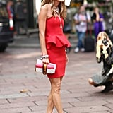 Anna Dello Russo kept to her signature style formula: bold minidress plus even bolder accessories. Source: Greg Kessler