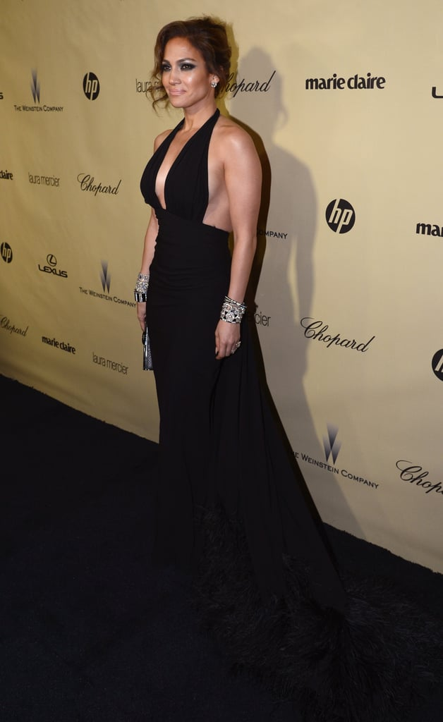 Jennifer Lopez switched gears and this time around, she opted for a sexier halter-style gown in black at the Weinstein party.