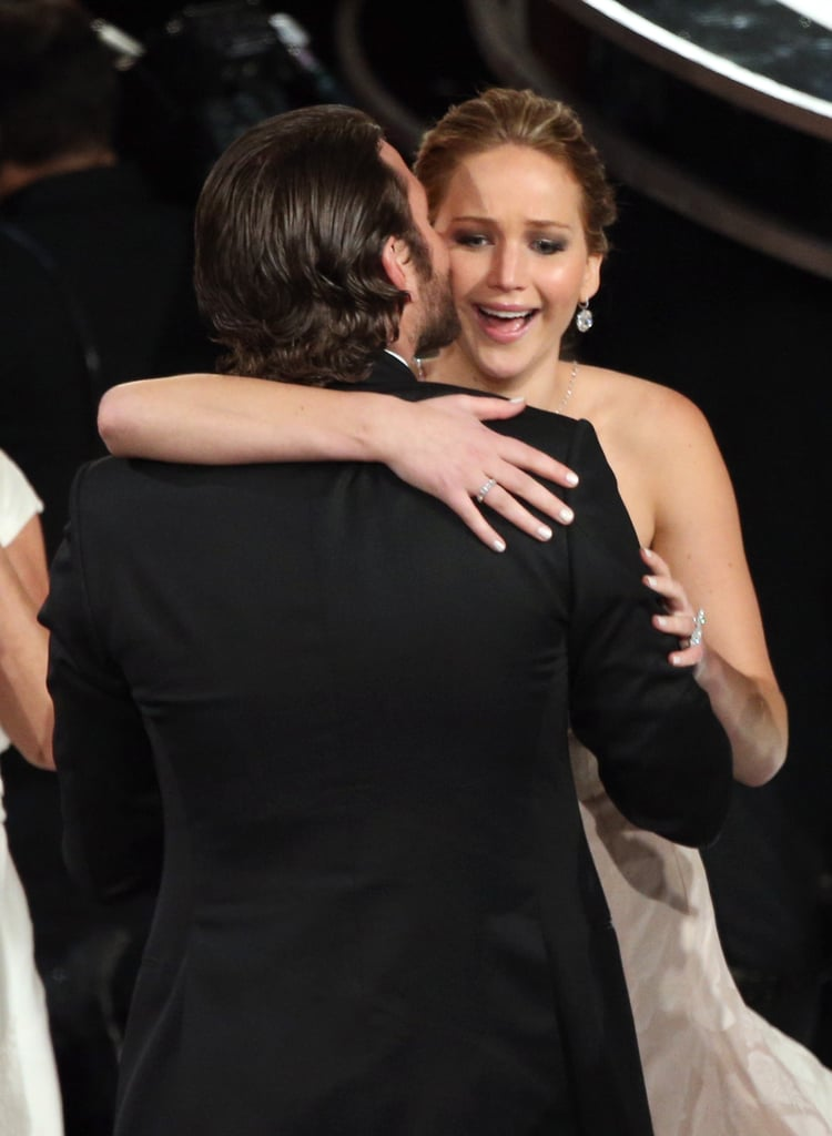 Bradley Cooper kissed Jennifer Lawrence at the 2013 Academy Awards after her win for best actress on Sunday night.