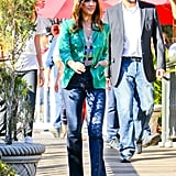 Jessica Alba in a green jacket.