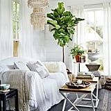 Bright windows, comfy seating, and lush greenery are all a loyal Hufflepuff needs to create their ideal living room.   via Homepolish
