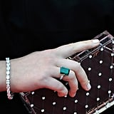 Jennifer Lawrence wore a Chopard square-cut emerald ring and diamond bracelet and carried a clear Lucite clutch.