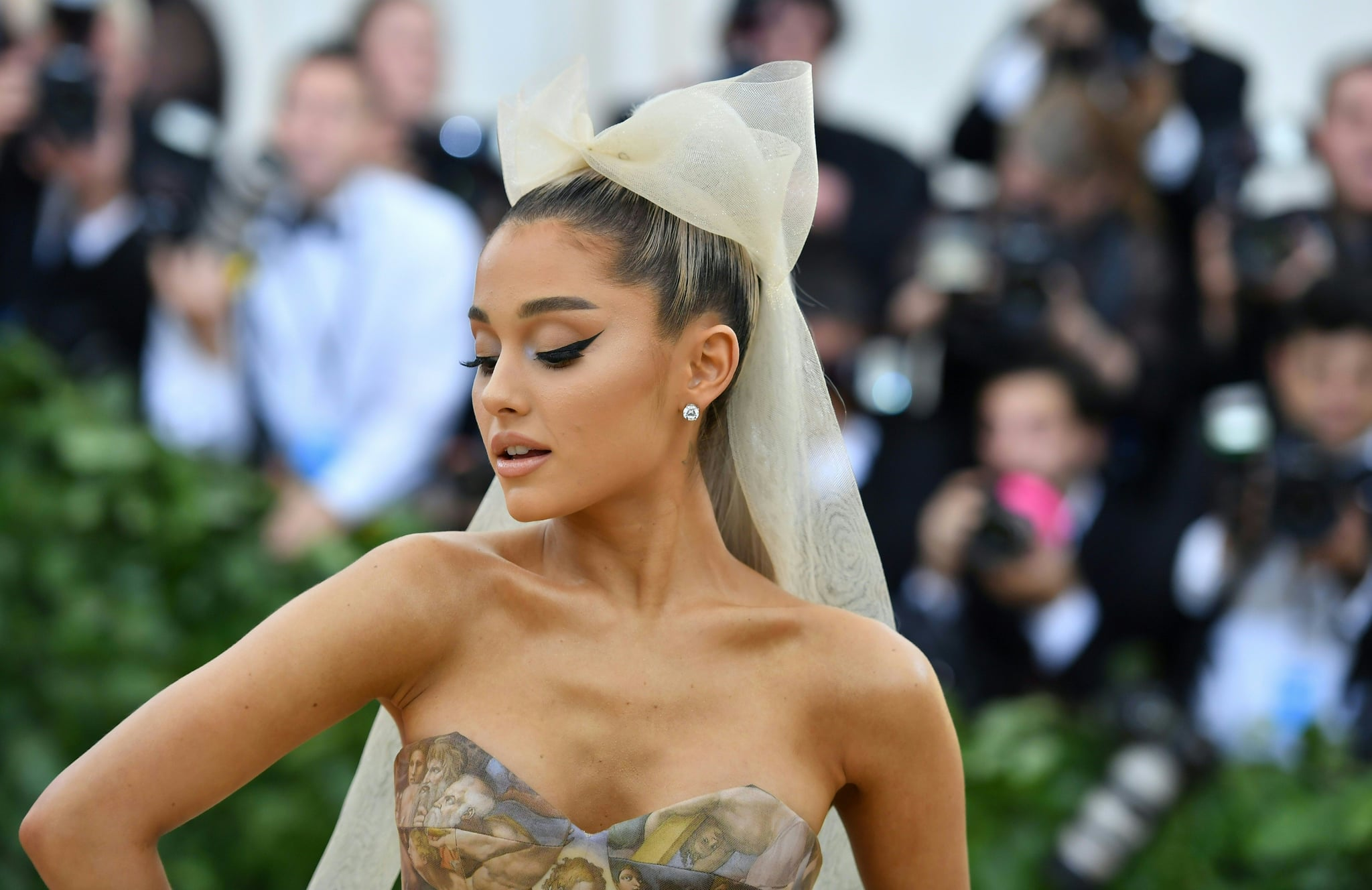 Ariana Grande arrives for the 2018 Met Gala on May 7, 2018, at the Metropolitan Museum of Art in New York. - The Gala raises money for the Metropolitan Museum of Arts Costume Institute. The Gala's 2018 theme is Heavenly Bodies: Fashion and the Catholic Imagination. (Photo by Angela WEISS / AFP)        (Photo credit should read ANGELA WEISS/AFP/Getty Images)
