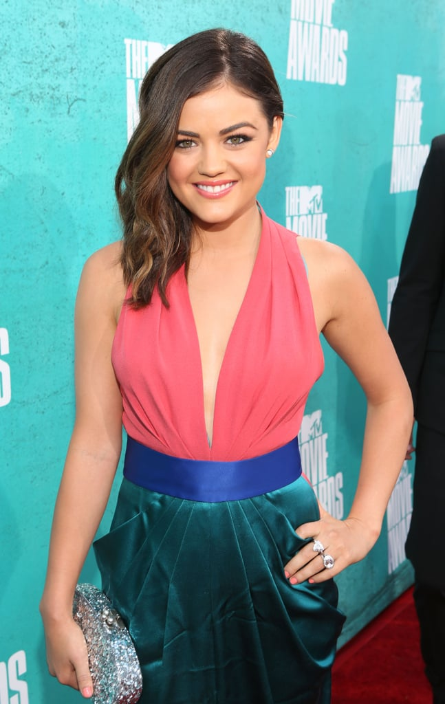Lucy Hale hit the red carpet at the MTV Movie Awards in a colorblocked halter dress and shimmery stacked rings.